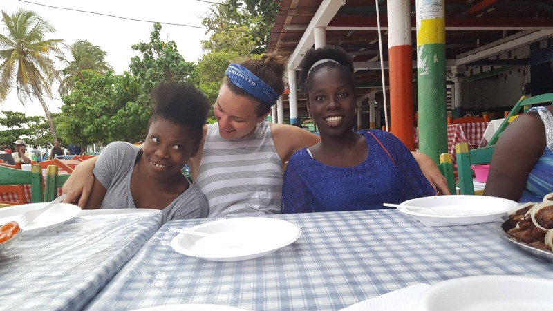 Nancy, Courtney, and Dailove (left to right) at our special dinner at the beach to recognize our pen pals and their Fi Ki Fò program teachers.