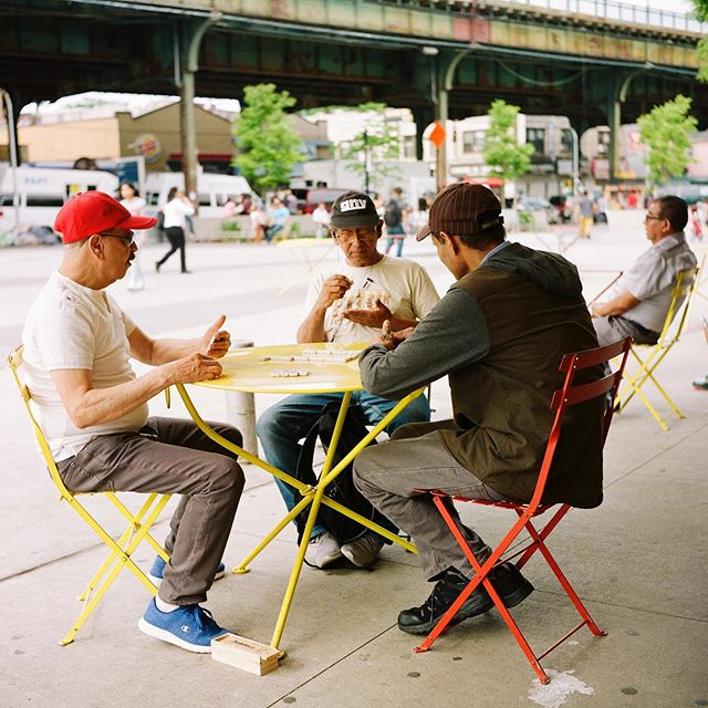 Three men play a game of dominoes, Jackson Heights, New York City, 2019 • • • • • • #120mm #35mm #film #filmphotography #streetphotography #lensculture #rolleiflex #rollei #mediumformat #analog #analogphotography #blackandwhite #ektar100 #portra400 #cinestill #kodak #madewithkodak #losangeles #dtla #portrait #portraiture #newyork #nyc #manhattan #brooklyn #jacksonheights