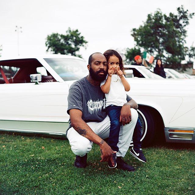 Randall and his son, Joaquin (AKA skrimp and Q), Carson, Los Angeles, 2019 • • • • • • #120mm #35mm #photography #filmphotography #film #streetphotography #lensculture #rolleiflex #rollei #mediumformat #analog #analogphotography #blackandwhite #ektar100 #portra400 #cinestill #kodak #madewithkodak #losangeles #dtla #portrait #portraiture #latino #latinoamerica #lowrider #westcoastlowriders #newwork