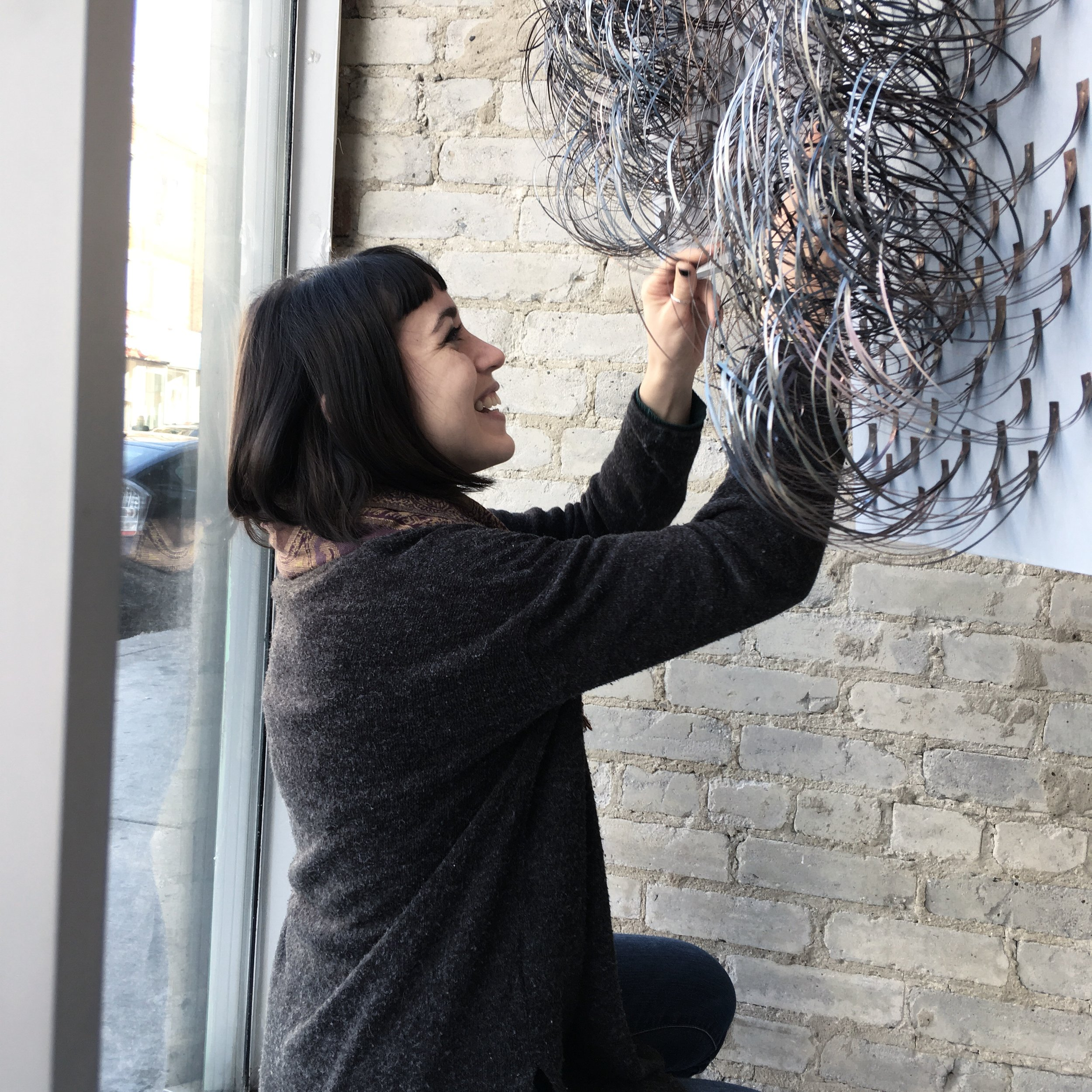 Installing my pieces in the window of Muddy George in Toronto.