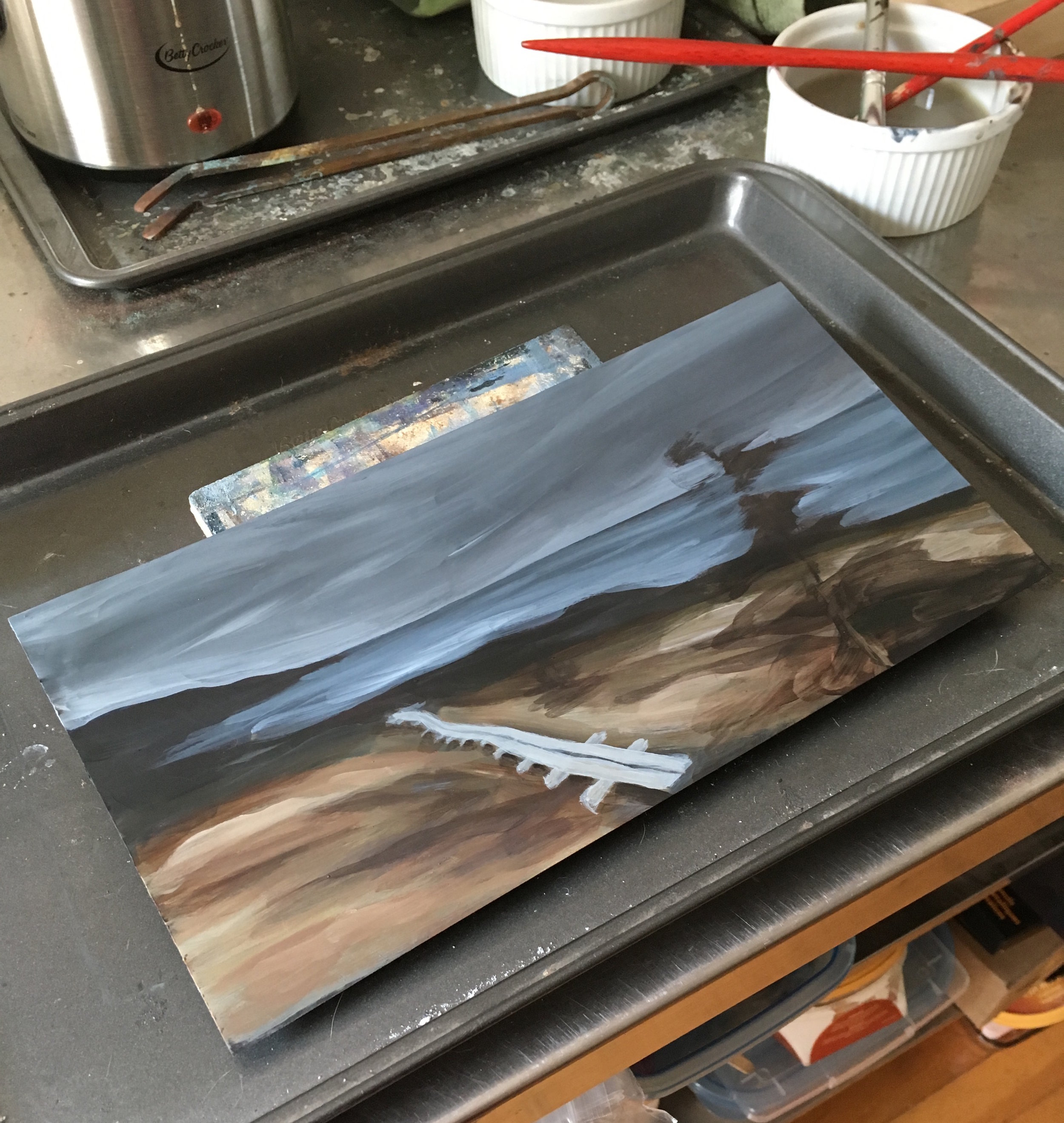The beginning stages of a painting on copper based on hike at Bay Bulls, NL.