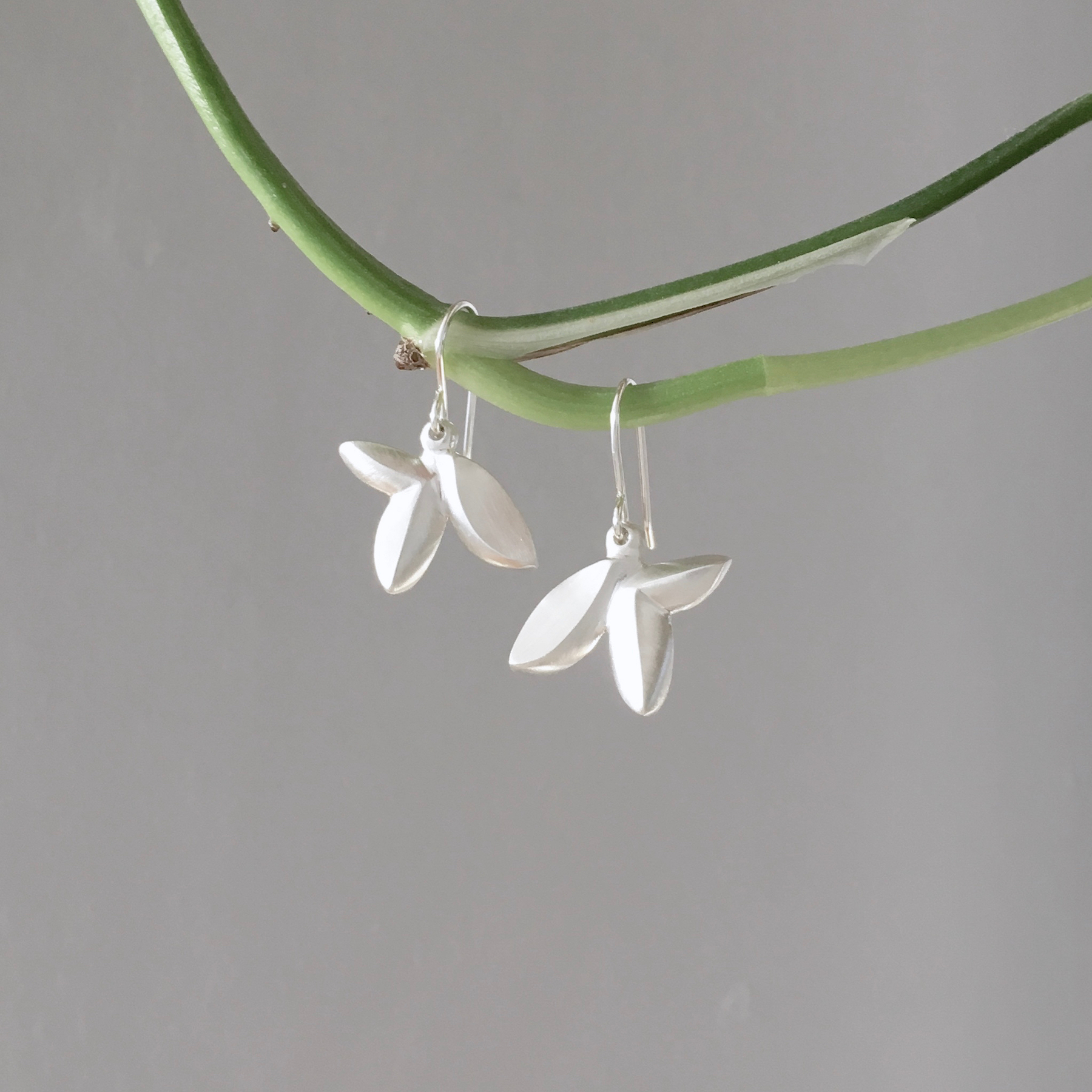 Silver floral drop earrings by K. Claire MacDonald