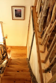 Staircase decorated with beautiful entwined driftwood branches which are incorporated throughout the house.