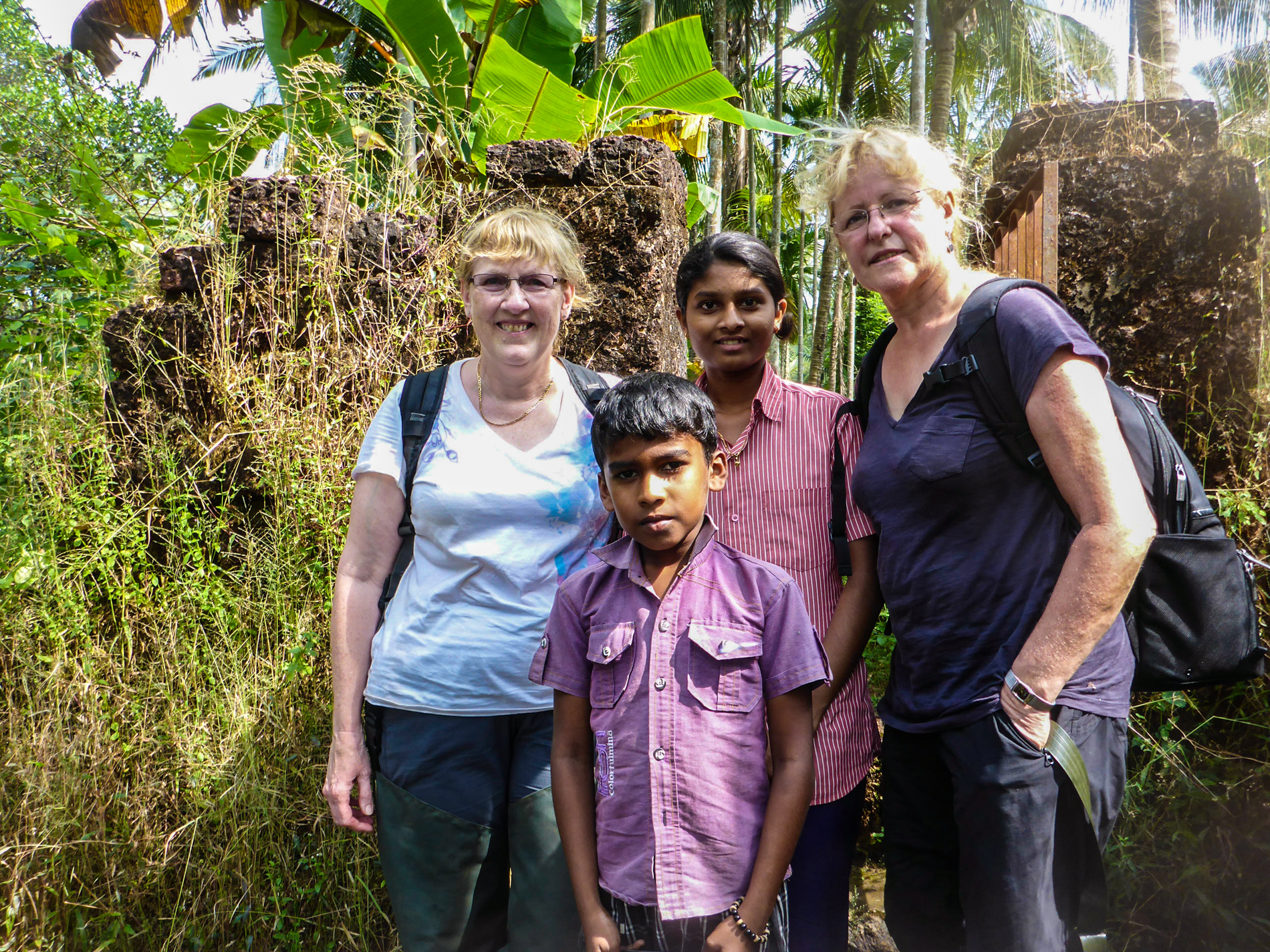 Karen and Christel visit with some local children in Kerela, India.