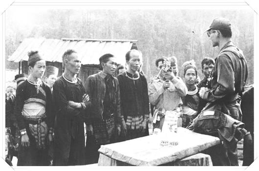 His Majesty (right) introducing arabica coffee to a hill tribe, c.a. 1971.