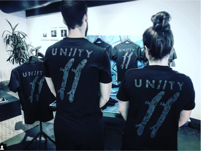 / /June 15, 2017 - UN//TY x OSF T-SHIRT LAUNCH- AT THE lululemon LOCAL - The first UNIITY T-Shirt designed incollaboration with Oasis Skateboard Factory &Kwest is launched on June 15th at the lululemonLocal at 96 Ossington. The event gathered community supporters for a one time opportunity topurchase the one-of- kind shirts and 100% of the proceeds went to support OSF & theirincredible alternative arts program for at-risk youth.