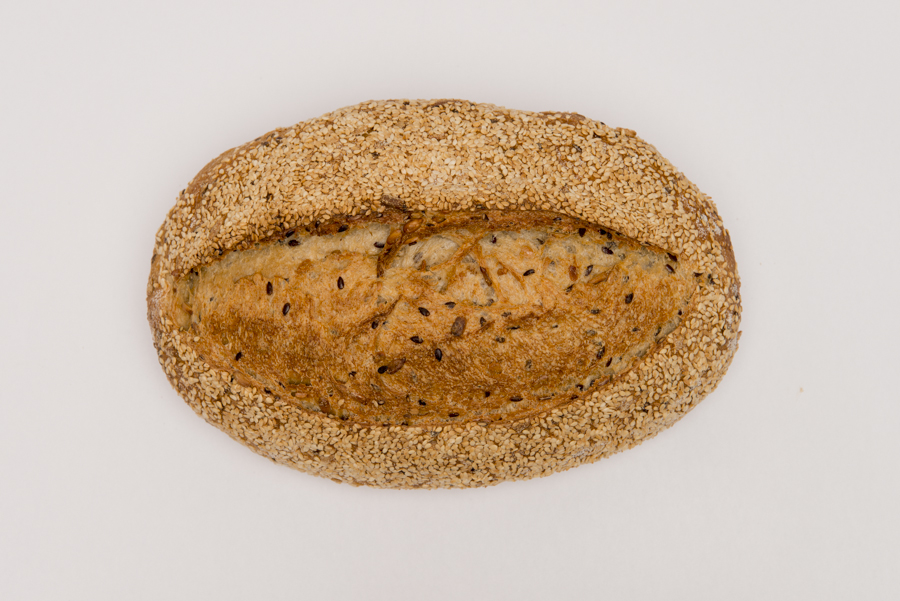 Grain Loaf  - One of our most popular loaves. A mix of certified organic stoneground, wholemeal and white wheat flours blended with linseed and sunflower kernels. All wrapped up in sesame seeds.