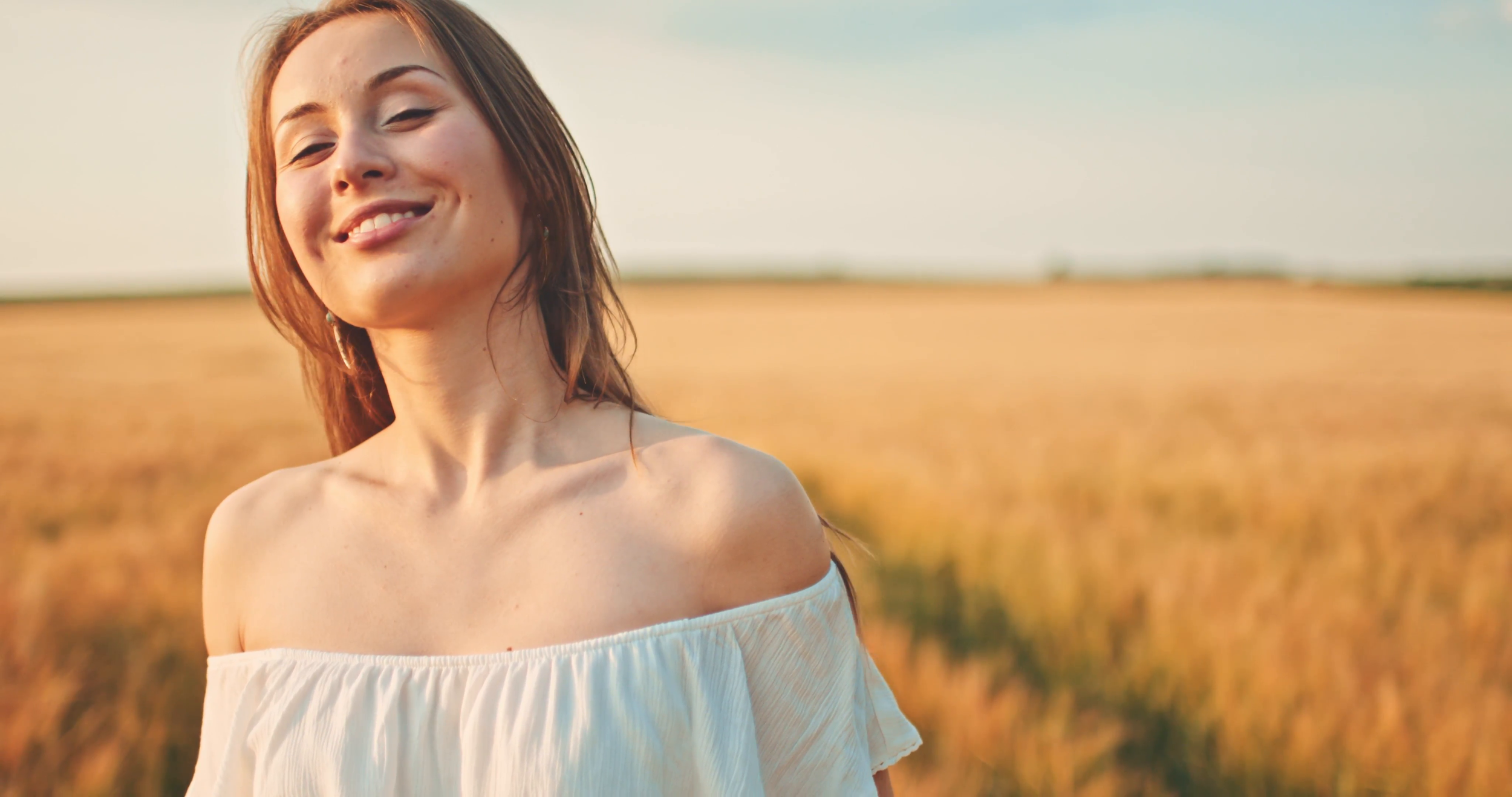 beautiful-girl-running-on-sunlit-wheat-field-slow-motion-120-fps-freedom-concept-happy-woman-having-fun-outdoors-in-a-wheat-field-on-sunset-or-sunrise-slowmo-harvest_4wzyqqe4il__F0000.png