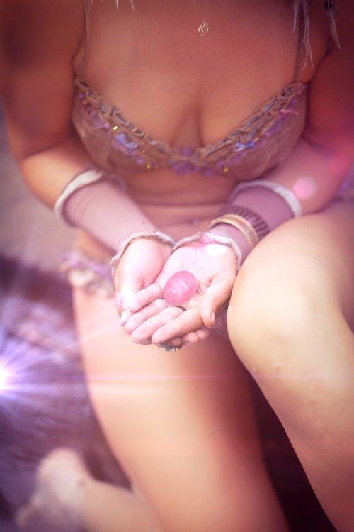 Rose+Quartz+Yoni+Egg+in+woman's+hand+in+Bali.jpg