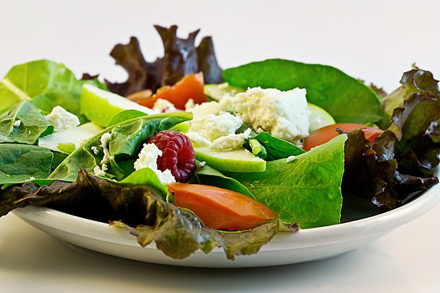 """Mix your salad with new ingredients. Add taste of choice, but think """"calorie free"""""""