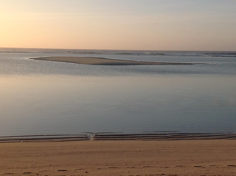 The Sand Island rises as the tide falls