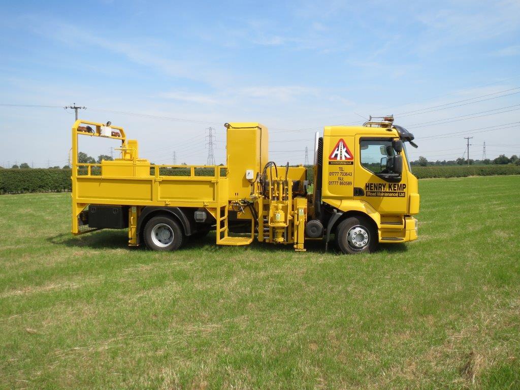 Henry Kemp road stud insertion machine