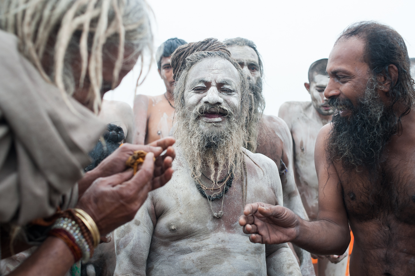 Sadhus relaxing after bathing