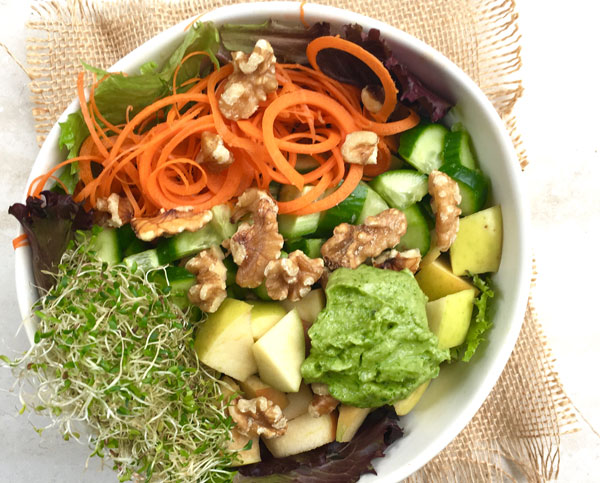 picture of a delicious waldorf and apple salad with apple, walnut, cucumber, guacamole
