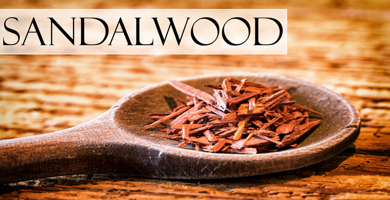crushed sandalwood on a wooden spoon