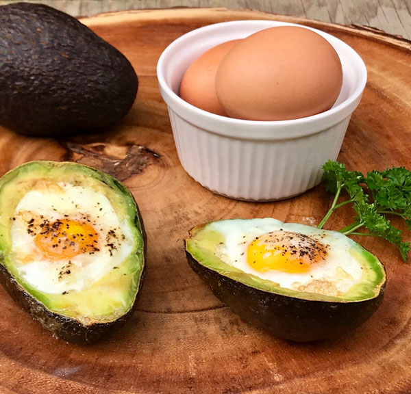 A healthy and nutritious breakfast from nutritional therapist in london, tracy tredoux. Baked avocado egg cups.