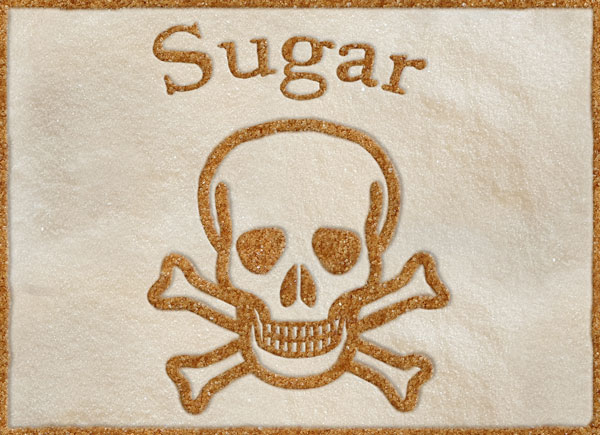 a skull and crossbones made of white and brown sugar copyright Tracy Tredoux Nutritional Therapy 2019