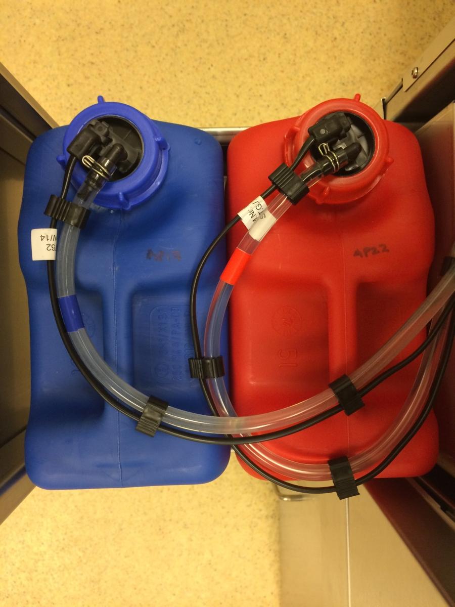 Miele G 7883 CD dishwasher detergent dispenser bottles.JPG