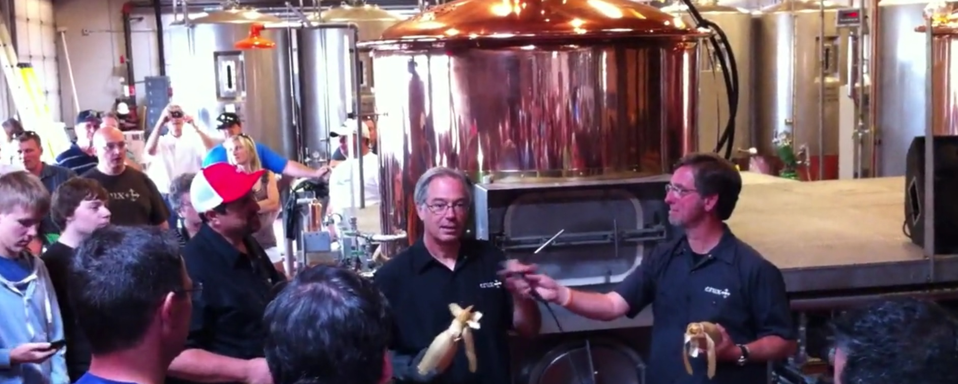 Larry Sidor (left) christening the new brewhouse at Crux Fermentation Project