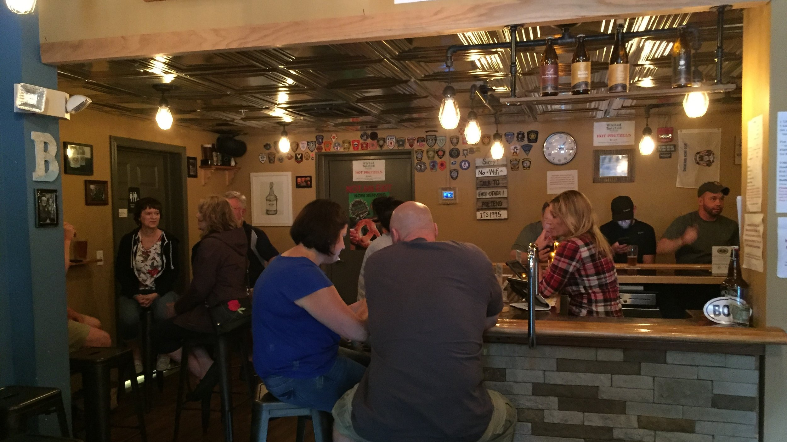 The cozy taproom at Bog Iron.