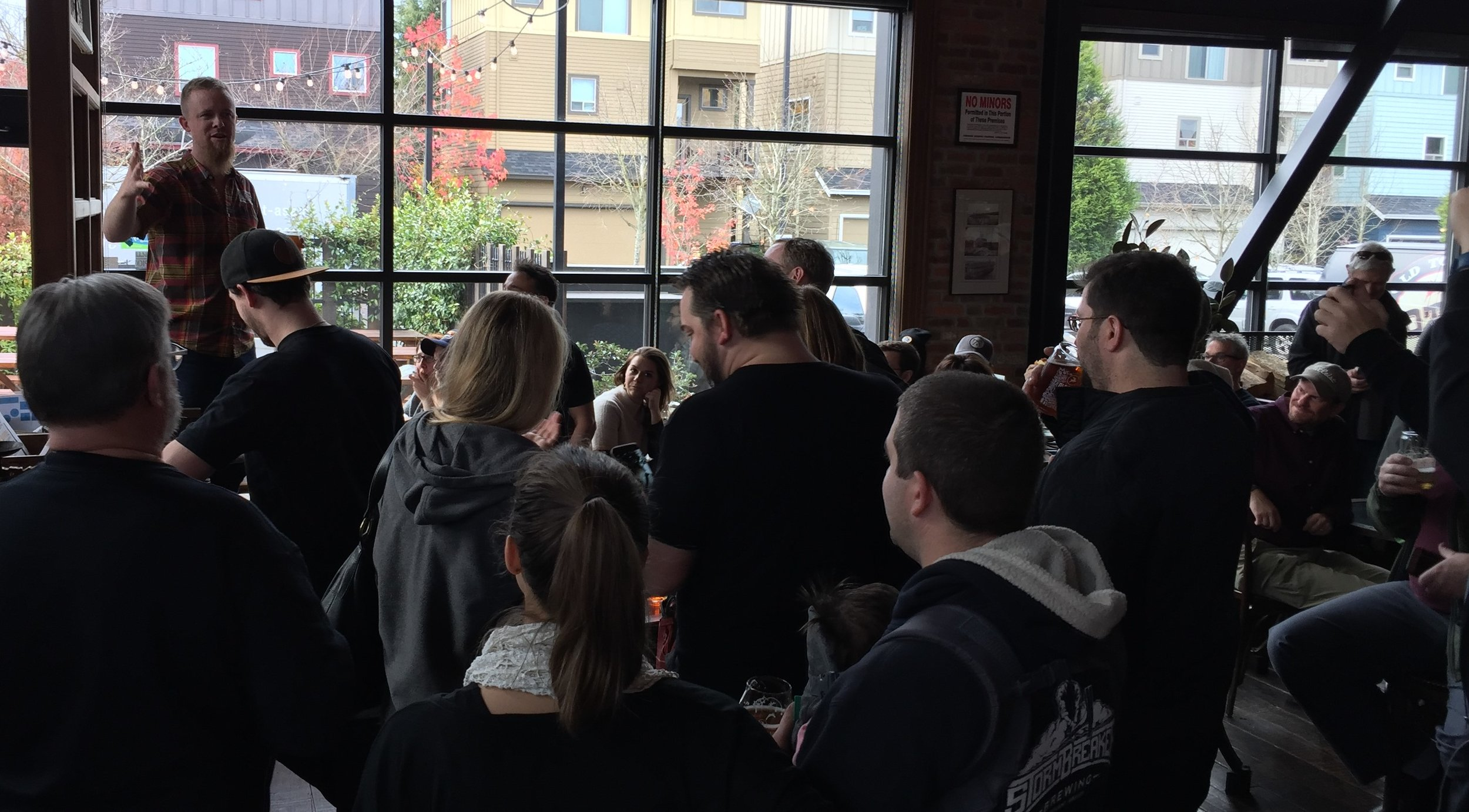 (Reverend) Nat West rallies supporters of Old Town Brewing.