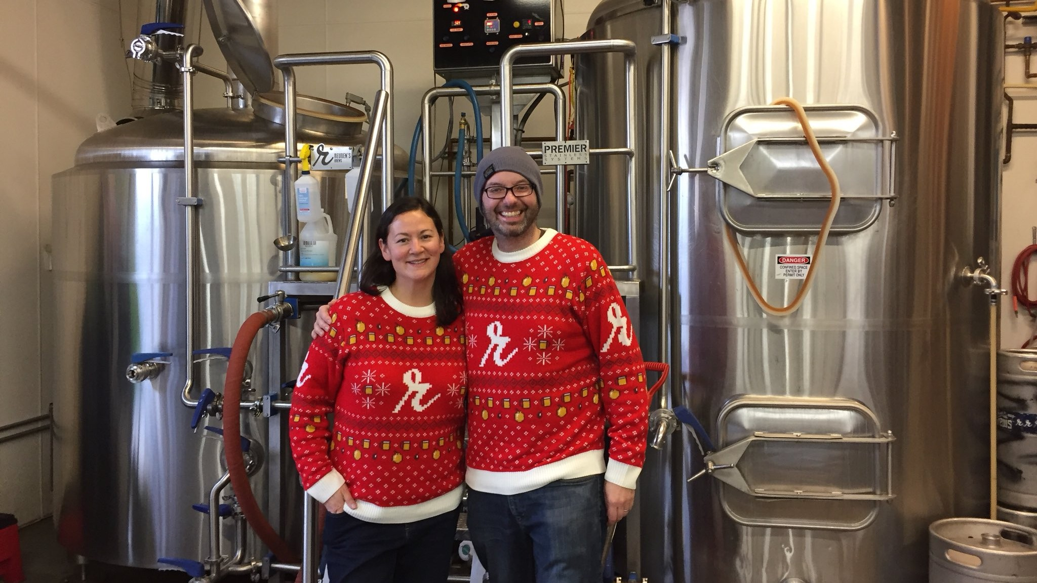 Adam and Grace Robbings of Seattle's Reuben's Brews in their holiday sweaters.