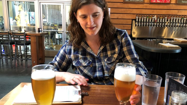 Tracey Hensley, one of the homebrewers I interviewed for Homebrew Con, in front of her kölsch.