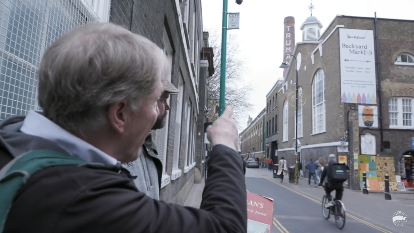 In London, the bones of the dead are still visible. Derek Prentice points at the Truman brewery smokestack.