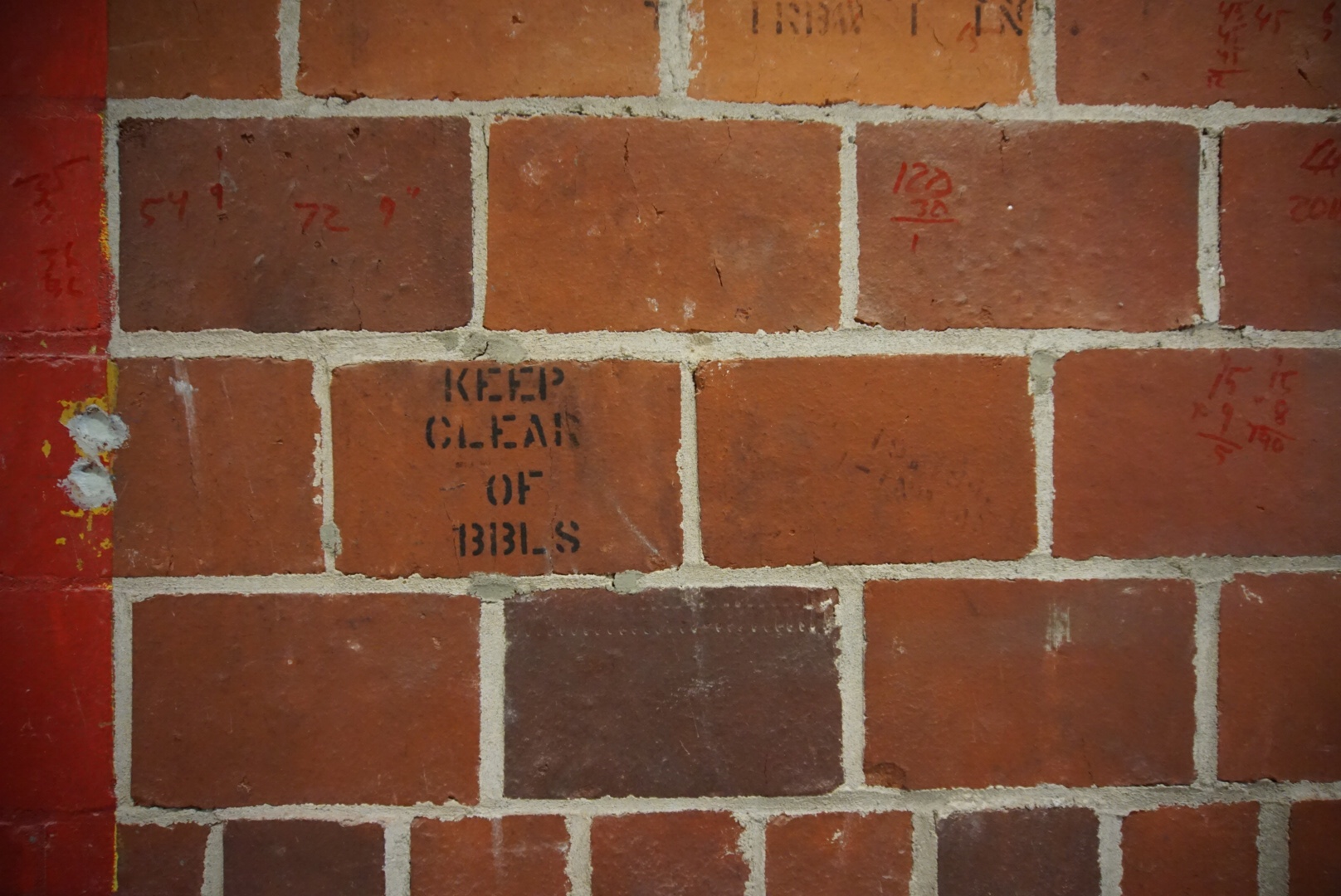 If you stop to study the walls, you see evidence of the building's former life as a liquor rickhouse (barrel warehouse).