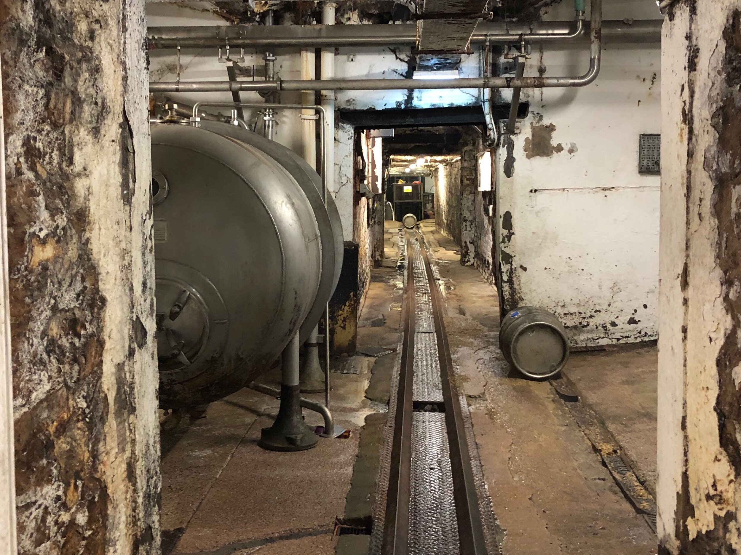 Rails for rolling casks. They go right under the office, where the rumbling is  very  loud. It's like a gravel truck driving by.
