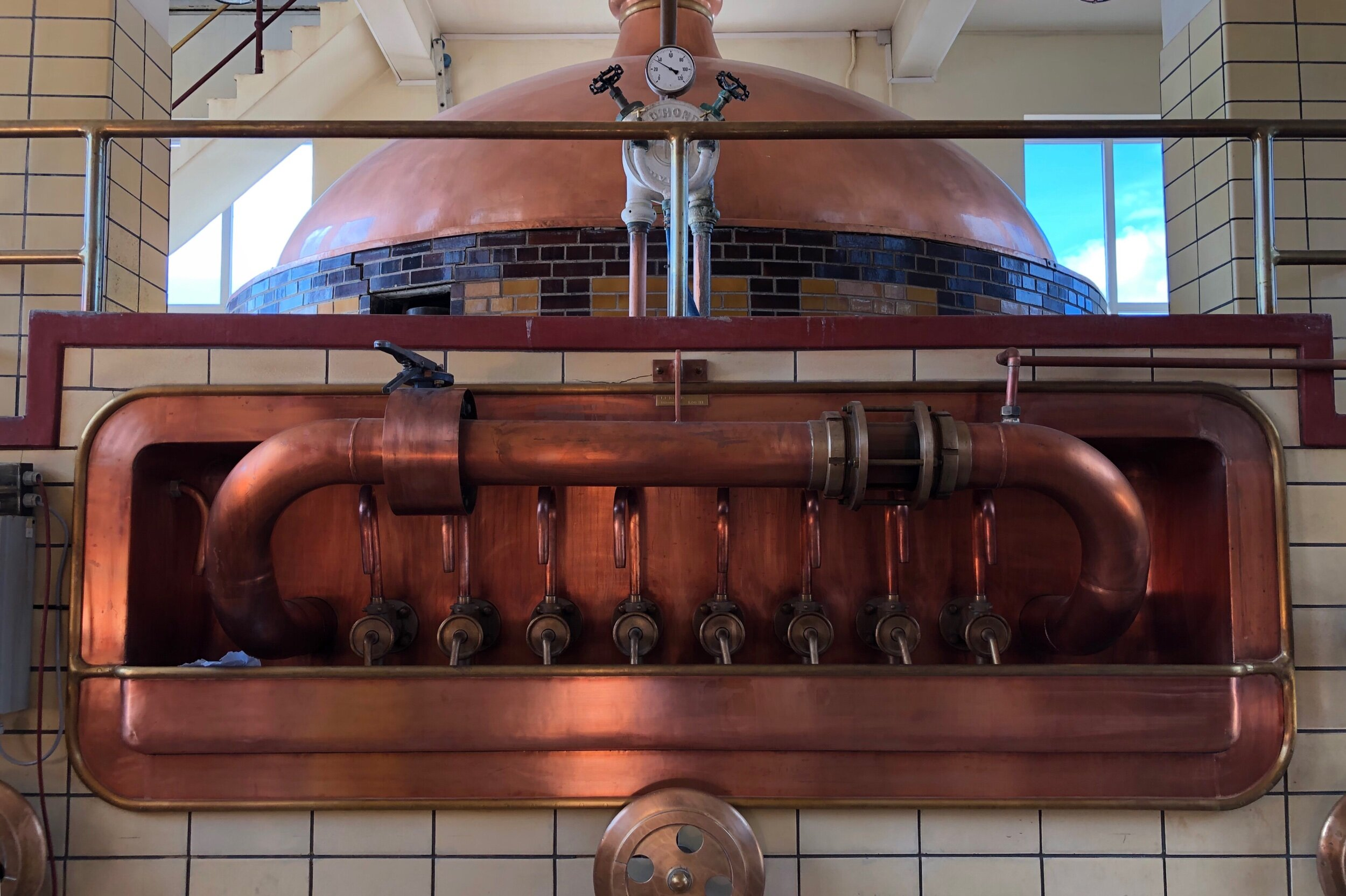The mash tun in an alcove above the grant, which the brewery no longer uses. This was an absolute classic design.