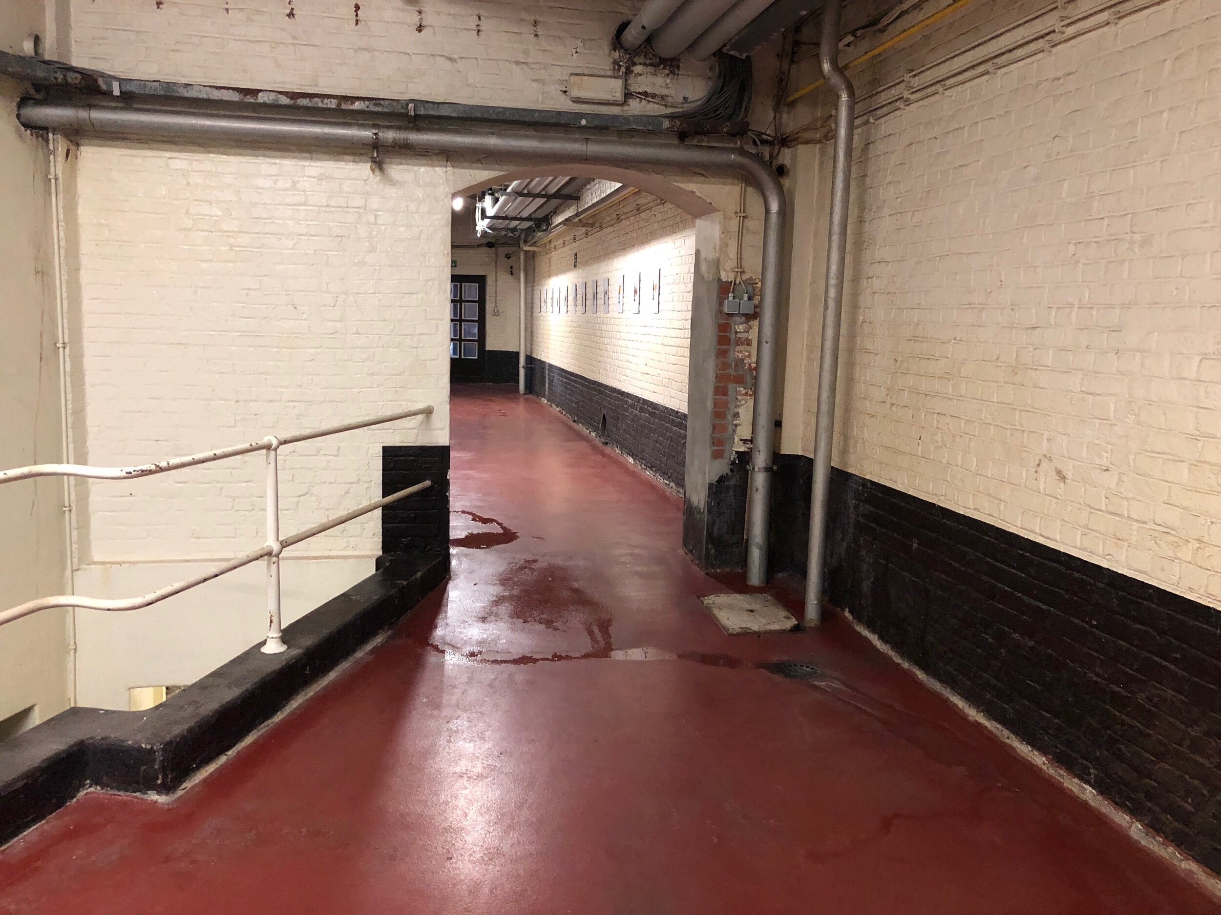 The entire brewery was scrubbed and neat as a pin—even this passageway between the brewhouse and cellars had recently been mopped.