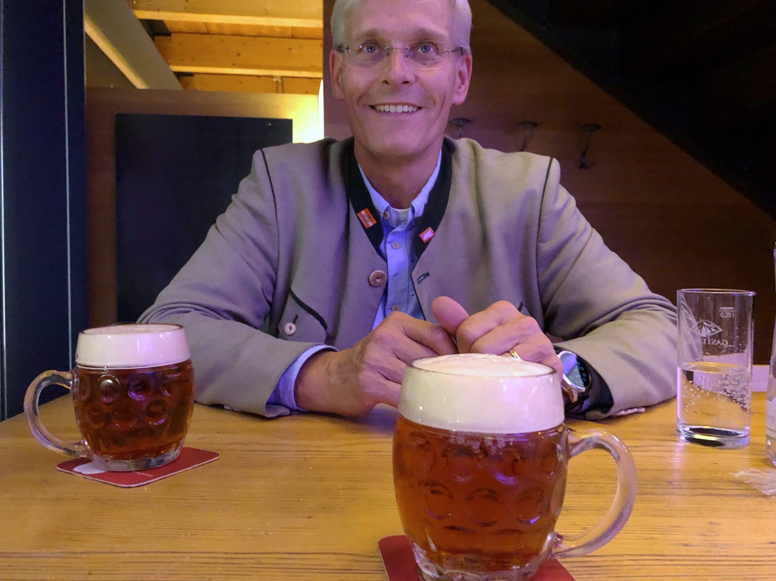 Andreas Urban and freshly-poured mugs of Vienna lager.