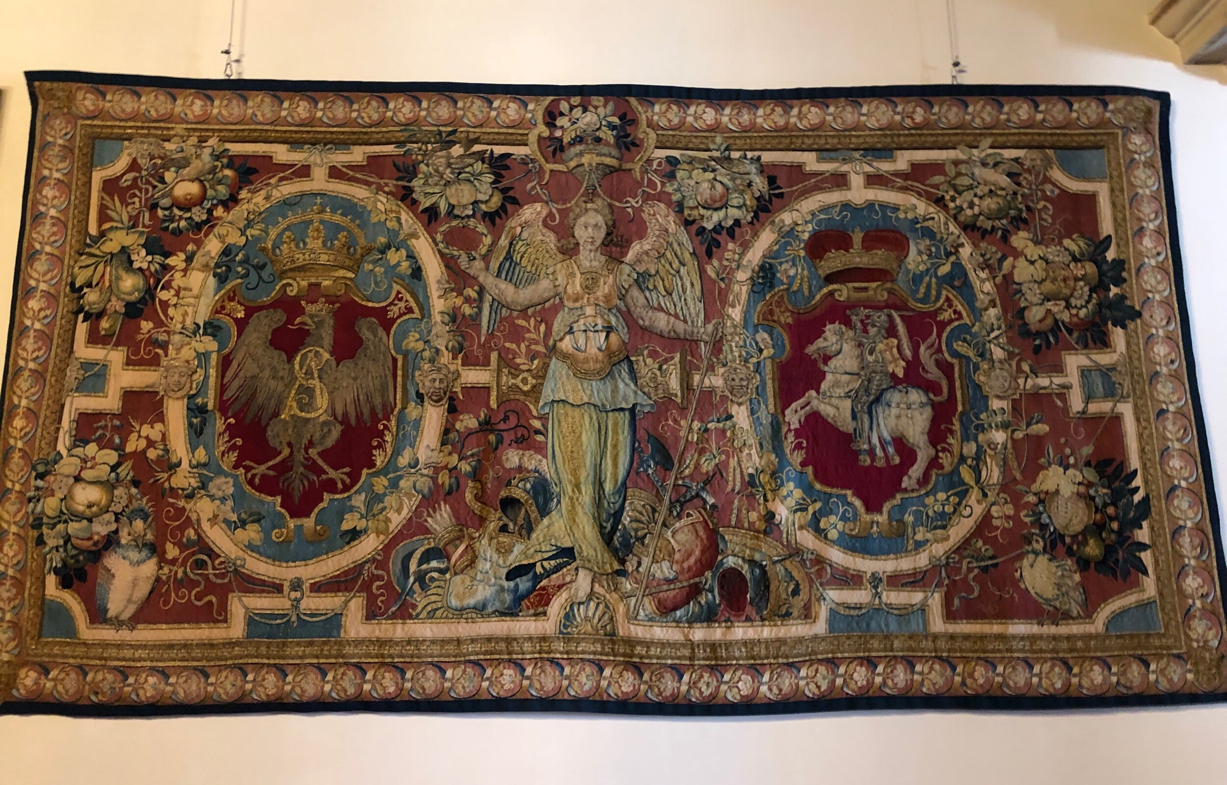 A Flemish-made tapestry depicting the seals of Lithuania and Poland hanging in Wawel Castle, Kraków.