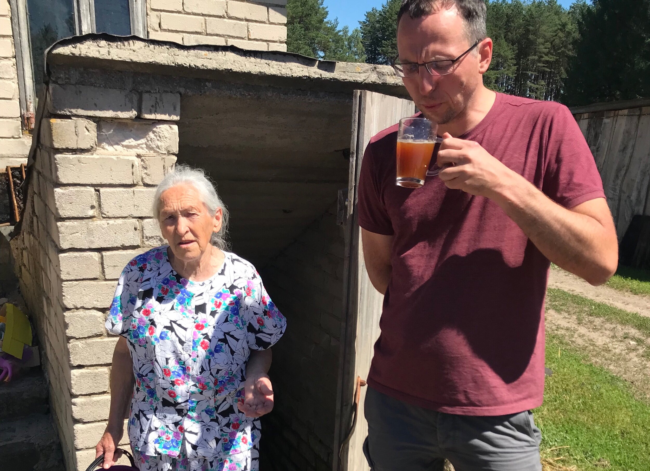 Martynas Savickis drinking a keptinis brewed by Ona Giriūnienė in Južintai village, Panevėžys district. She makes the beer in the outer kitchen of her barn, and I would very much love to visit her! (Photo courtesy Martynas)