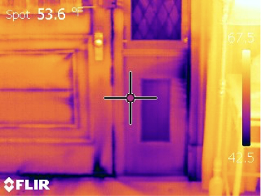 Cold air revealed via IR camera. Air movement is encouraged by creating a negative pressure environment within the house using a blower door setup