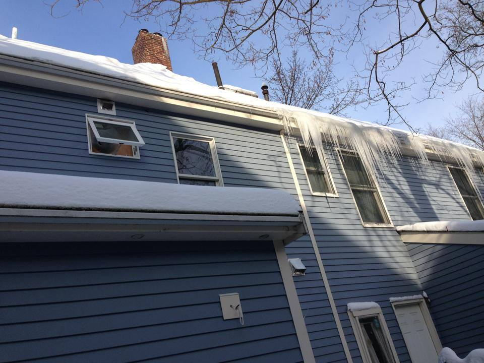 It was not possible to address air leaks in the middle section of the walls in this particular renovation. Nevertheless, the end results were striking. In the middle of the renovation project, there was a slew of wintry weather, which was a gift in that our team was able to see the results of our insulation scheme. In the photo below, the left side of the house is our client's side. The icicles seen on the right side (not our client) indicate heat loss, resulting in melting and subsequent refreezing (AKA ice damming). The side with no icicles or ice damming is the result of properly insulating and air sealing.