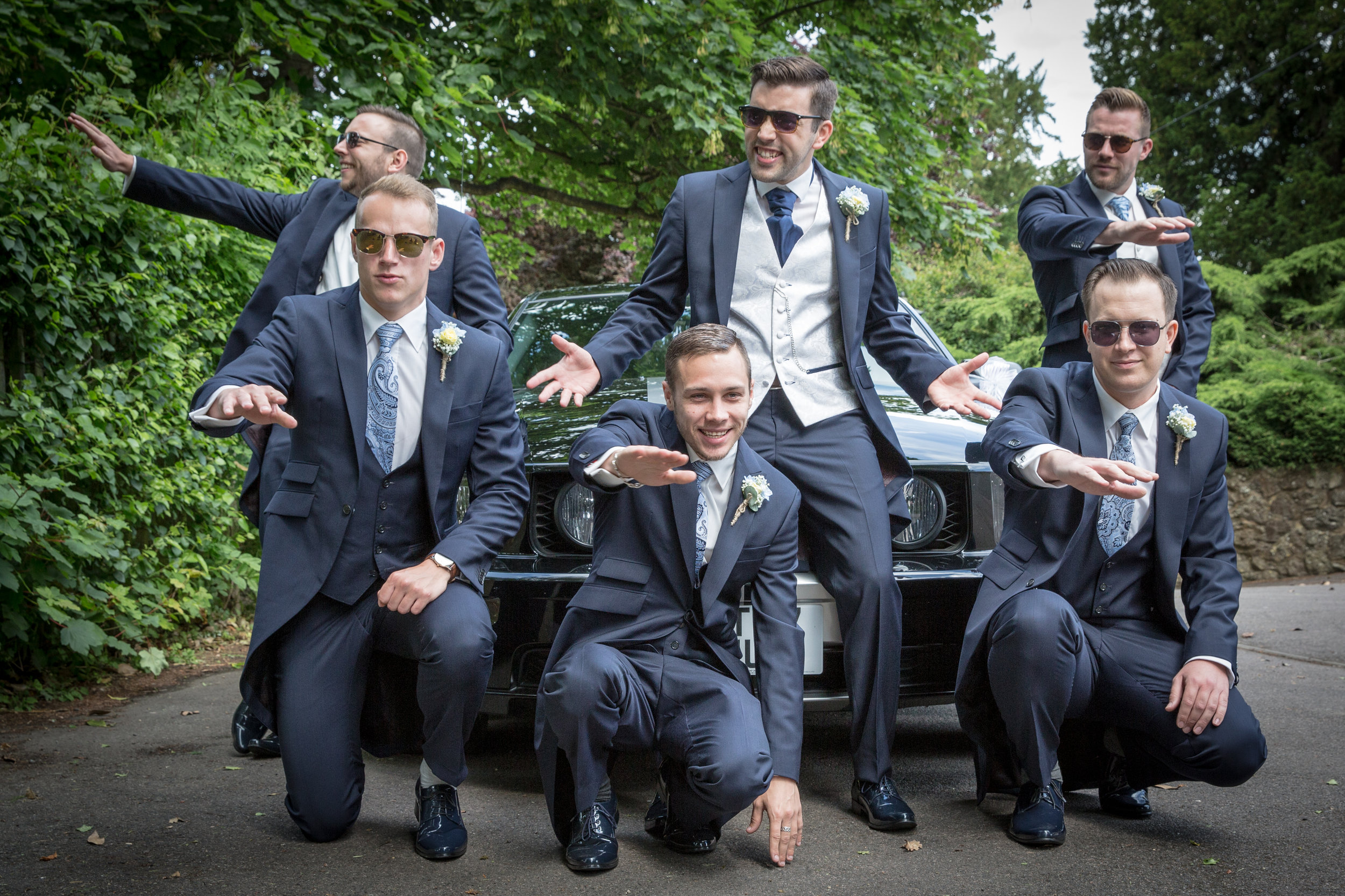 groomsmen on car