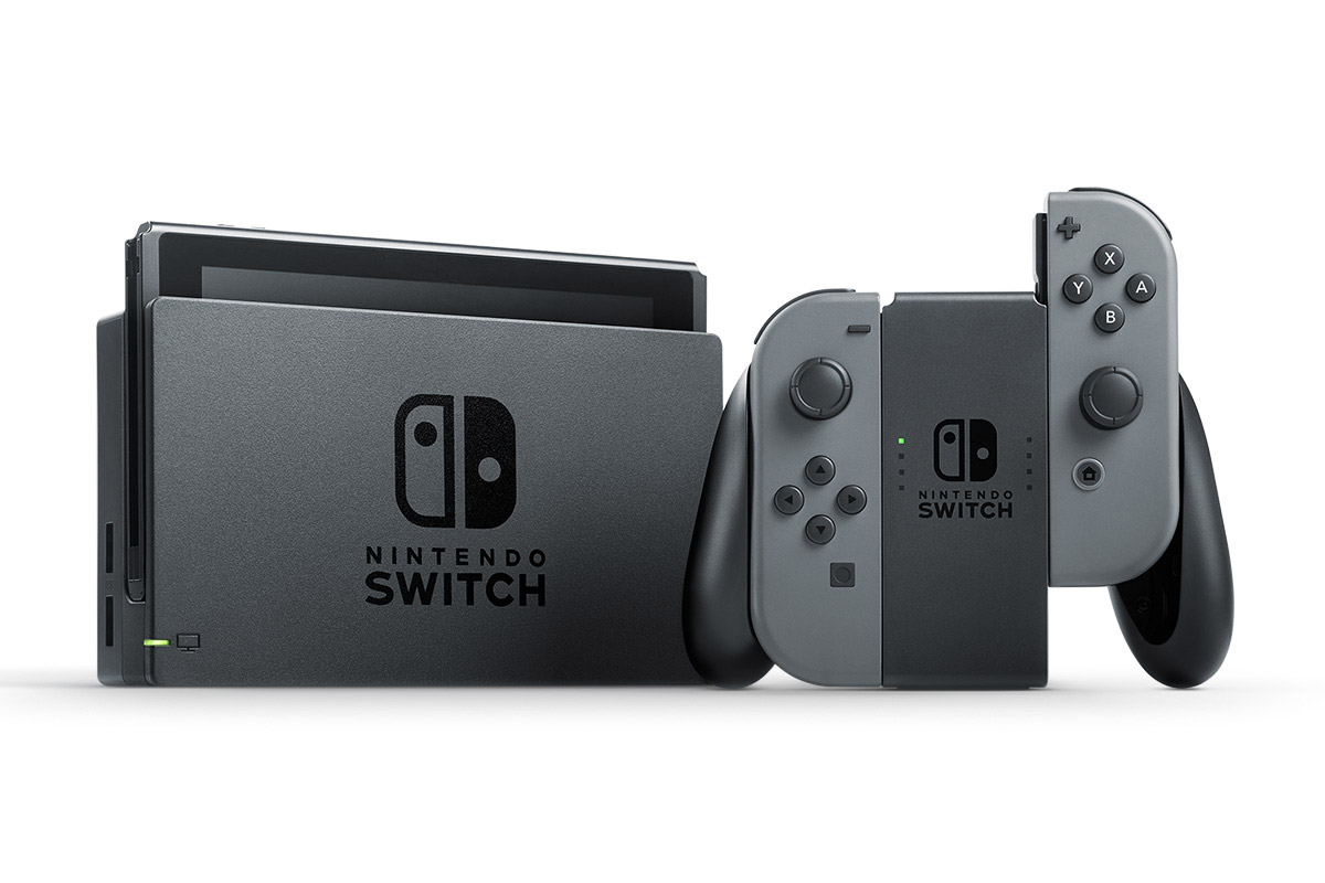 The Nintendo Switch console, dock and Joy-Con controllers in the grip.