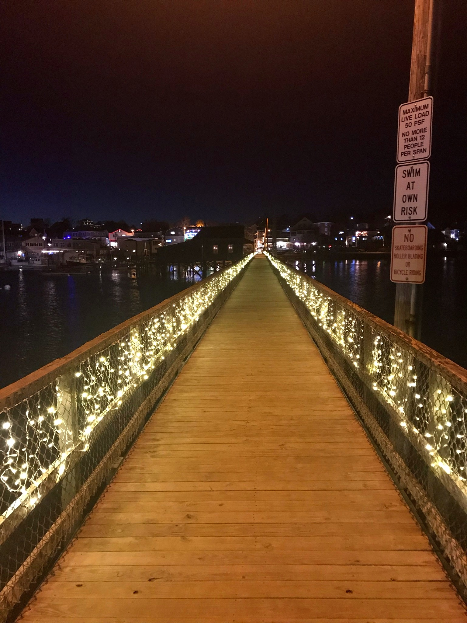 The beautifully lit path of the footbridge