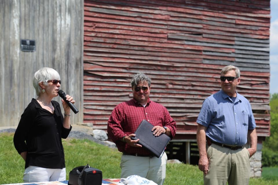 Barbara Adamson, left and John Adamson, right, Introduce Justin Sarafin of Preservation Virginia at the VIrginia's Most Endangered Announcement in front of the barn at Woodstock's Fairview Park. The town of Woodstock is considering converting the barn into an event space. If you would like to see this happen, contact the  Woodstock Town Office .