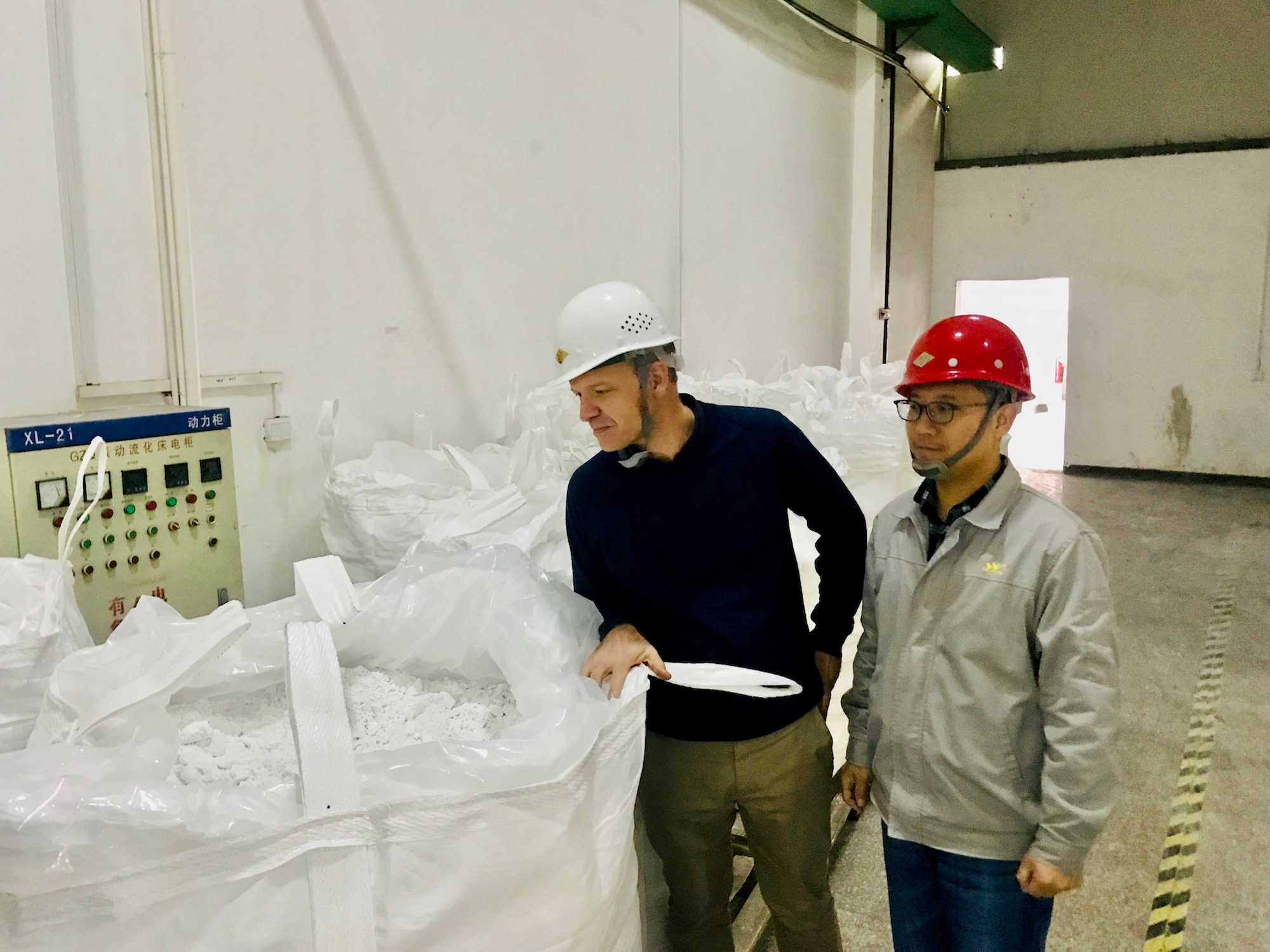 Hans Eric Melin, founder of Circular Energy Storage inspecting recycled lithium at a Chinese battery recycler.