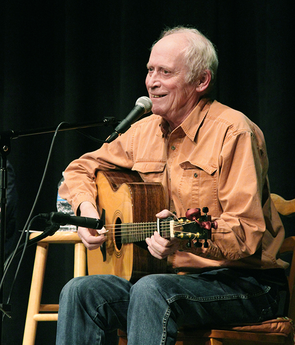 Archie Fisher performing at the Grange (photo by Margie Miller)