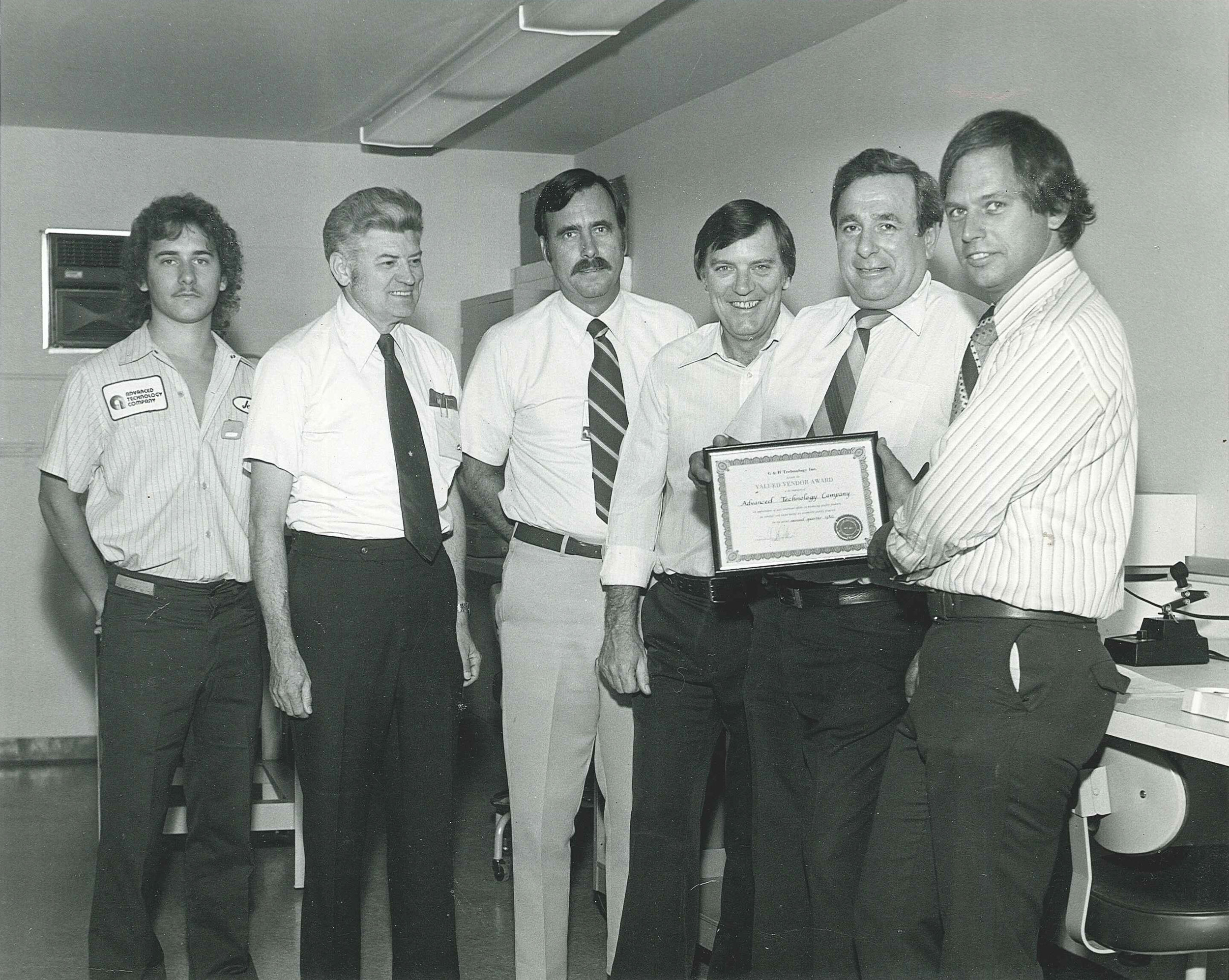 Pictured left to right: Jeff Lesovsky, ???, ???, founder Jay Frey, founder Bob DeSilvestri, and ???. circa 1980