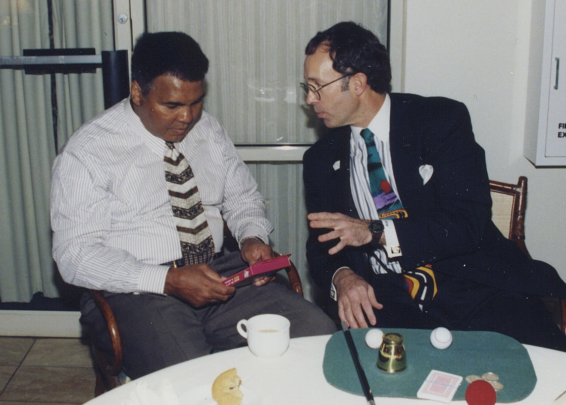 Hondo celebrity Muhammad Ali looking at Hondo magic kit.jpg