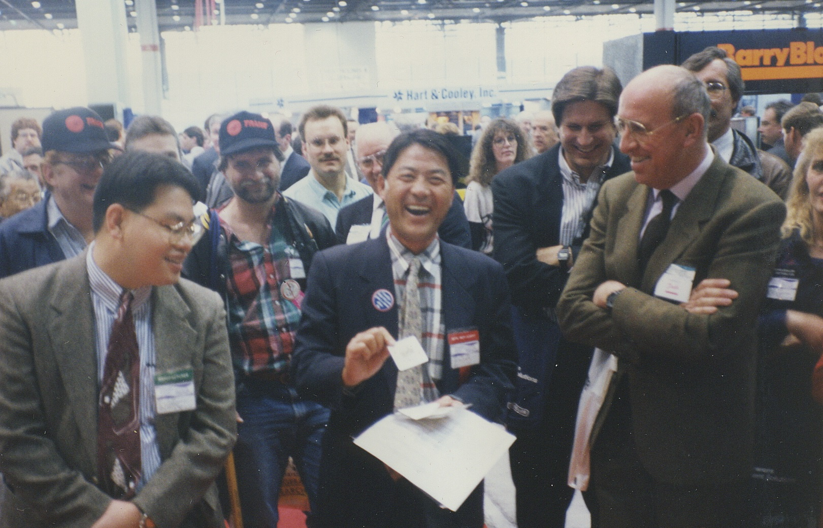 """The Amazing Hondo's view of happy faces on a busy trade show floor. """"The smarter the audience, the more fun to bamfoozle"""", says Hondo."""