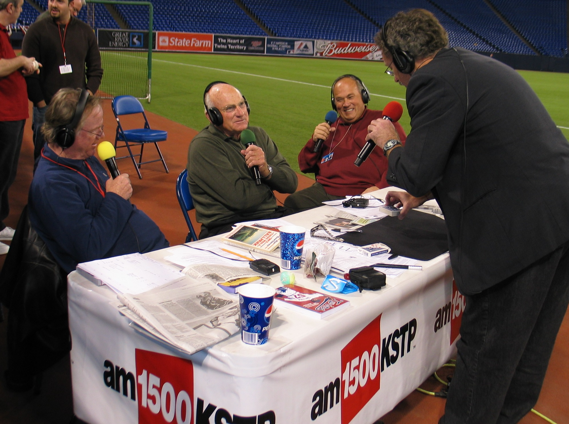 """Hondo performs """"Magic on the Radio"""" with baseball legend Harmon Killebrew and ESPN 1500 hosts Joe Soucheray and Patrick Reusse prior to a MN Twins game."""