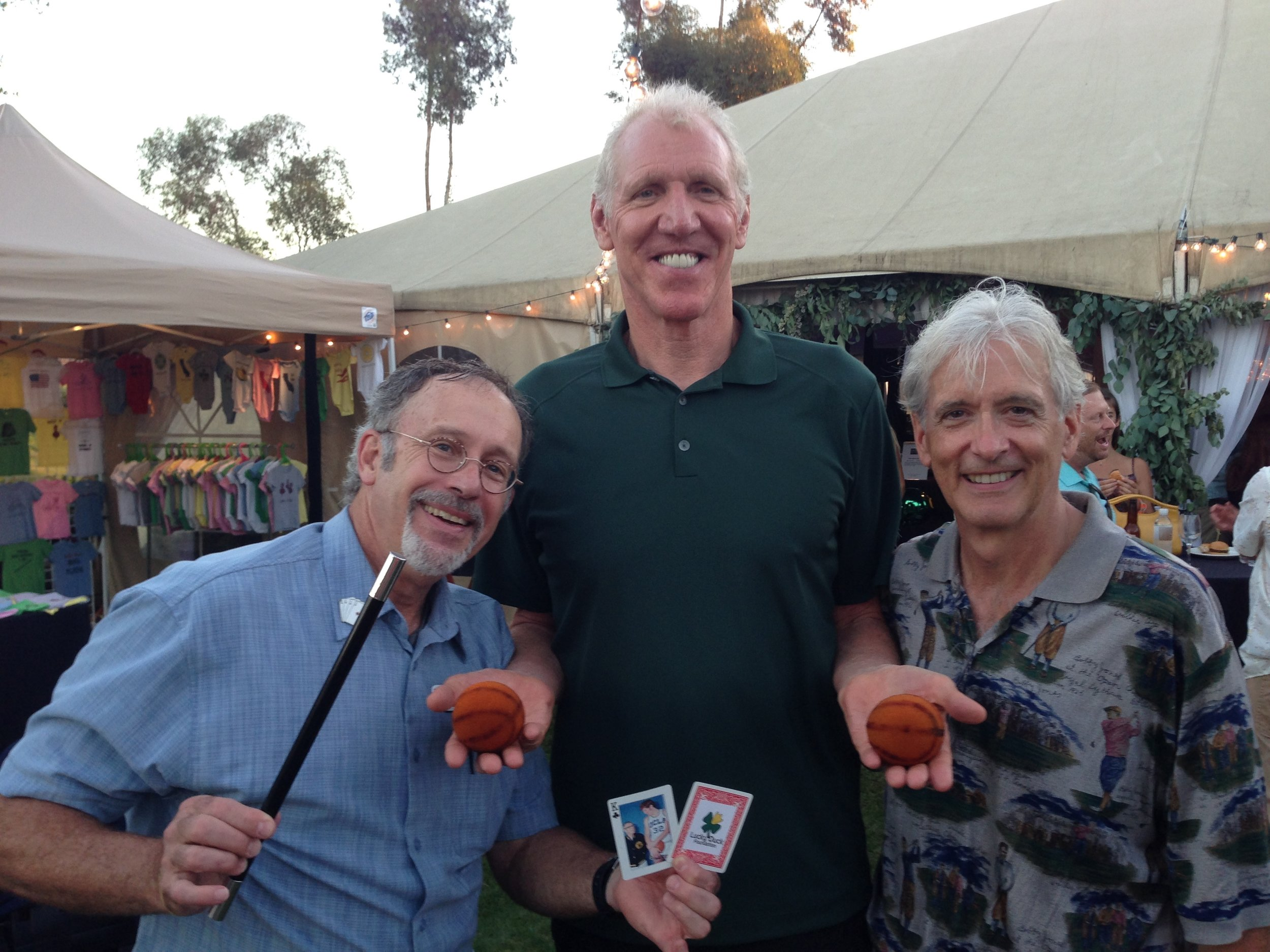 Hondo and friend Bill Fleischakker (the two short guys) with UCLA and NBA legend Bill Walton at the Lucky Duck Foundation golf benefit in Rancho Santa Fe, CA. Hondo kicked off the live auction with a stage show. Earlier he entertained the guests with his strolling close-up sleight-of-hand magic.