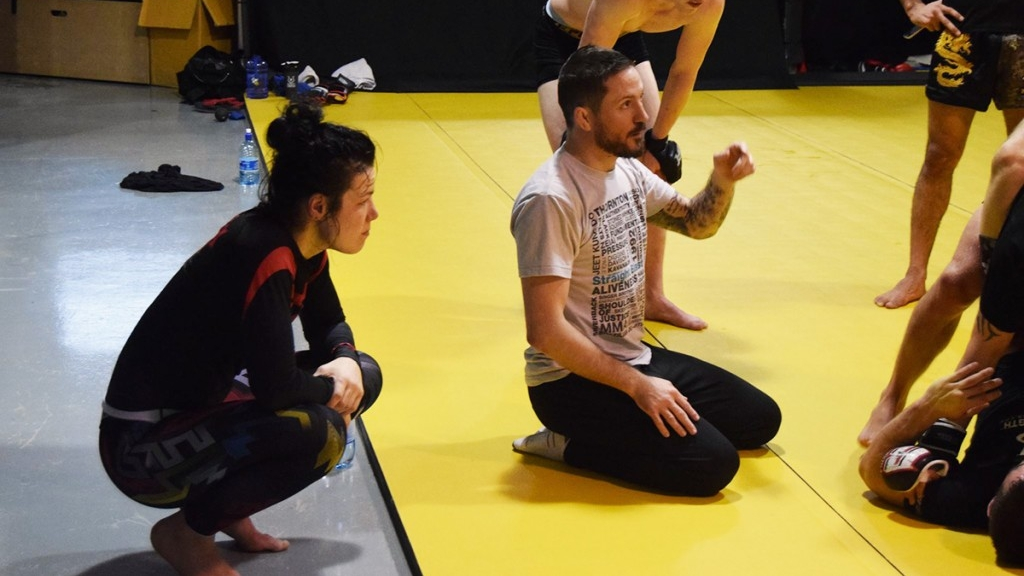 Listening attentively; Sinead's coach John Kavanagh sharing words of wisdom with Sinead and the pro SBG MMA team at a rolling session at SBG Dublin.