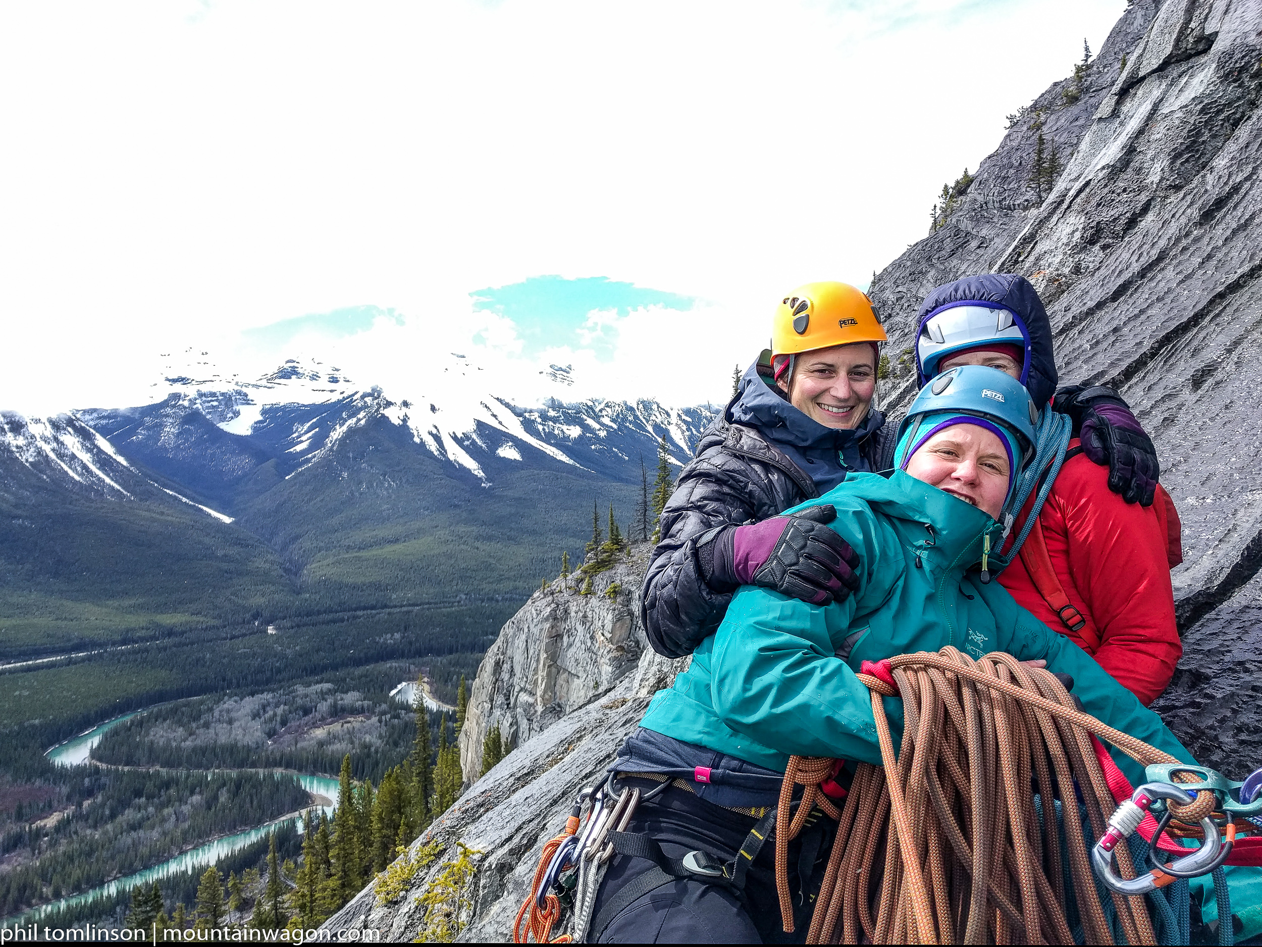 The advantage of sharing belay stances with another party is you can all huddle for warmth...